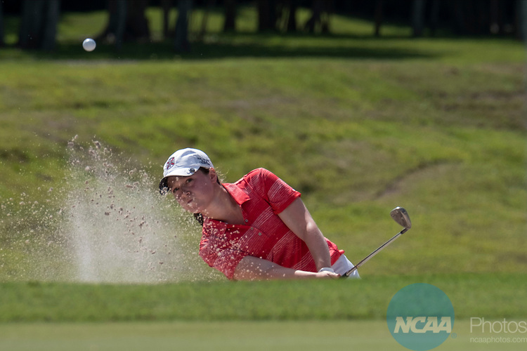 HOUSTON, TX - MAY 12: Nikki Isaacson of Rhodes College hits out of a sand trap during the Division III Women's Golf Championship held at Bay Oaks Country Club on May 12, 2017 in Houston, Texas.  Isaacson tied for second place overall and helped Rhodes College win the DIII National Championship with a team score of 1297. (Photo by Rudy Gonzalez/NCAA Photos/NCAA Photos via Getty Images)