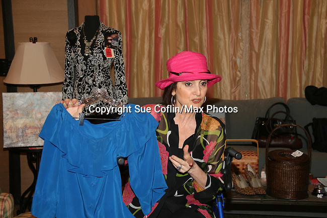 Robin Strasser of One Life To Live holds a Linda Dano outfit at an in-store appearance on August 16, 2009 at Housing Works Upper East Side Thrift Shop, New York City, New York. Robin donated a full rack of clothes and truckload of furniture to Housing Works and fans came to see and buy many many of  the items ranging from her great variety of clothes, jewelry, hats, furniture, backpacks and other items. This way the fans have momentos and wearables of Robin Strassers while donating to Housing Works. (Photo by Sue Coflin/Max Photos)