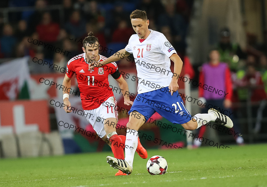 (copyright &amp; photo: STARSPORT)<br /> 12.11.16 - Wales v Serbia, FIFA World Cup Qualifier 2018 - Nemanja Matic of Serbia plays the ball as Gareth Bale of Wales closes in