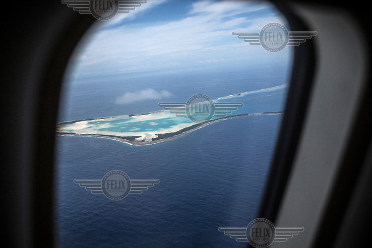 A view from an aeroplane of the Funafuti Atoll. <br /> <br />  Tuvalu has a population just over 10,000 people, most of whom live in the country's capital Funafuti. Increasing urbanisation, along with climate change, pose big threats to this tiny Pacific country. Migration from the outer islands to the main island of Fongafale is placing increasing pressure on water supplies and land availability, while employment opportunities in the small formal sector are limited. Moreover, stronger 'King Tides', Saltwater intrusion into the groundwater and extreme weather events are making this island nation one of the most vulnerable countries in the world.