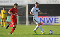 Partizan Belgrade's Dorde Ivanovic under pressure from Connah's Quay Nomads' Jamie Insall<br /> <br /> Photographer Kevin Barnes/CameraSport<br /> <br /> UEFA Europa League 2nd Qualifying Round 1st Leg - Connah's Quay Nomads v Partizan Belgrade - Thursday July 25th 2019 - Belle Vue Stadium - Rhyl<br />  <br /> World Copyright © 2019 CameraSport. All rights reserved. 43 Linden Ave. Countesthorpe. Leicester. England. LE8 5PG - Tel: +44 (0) 116 277 4147 - admin@camerasport.com - www.camerasport.com