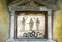 Italy: Pompeii--House of the Vetti, Lararium. Household shrine: Dancing Lares--twin sons of the Nymph Lara; Man in middle--the genius of the clan. The serpent is a symbol of the hearth.