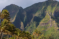 Rugged mountains and a waterfall on seen from Tunnels Beach in Ha'ena, north shore of Kaua'i.