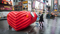 "Viewers engage with ""HeartBeat"" in Times Square in New York on Monday, February 9, 2015 by playing the various percussion devices built into the interactive sculpture. Designed  by Stereotank, the heart shaped sculpture gives off an audible heartbeat as visitors counterpoint it with their own percussion. This is the seventh installation for Valentines Day and it is tied in with the ""Love in Times Square"" promotion offering discounts on restaurants, hotels and other entertainment.  The installation will be on display until March 8. (© Richard B. Levine)"