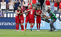 Commerce City, CO - Thursday June 08, 2017: Christian Pulisic and USMNT celebrate a goal during their 2018 FIFA World Cup Qualifying Final Round match versus Trinidad & Tobago at Dick's Sporting Goods Park.