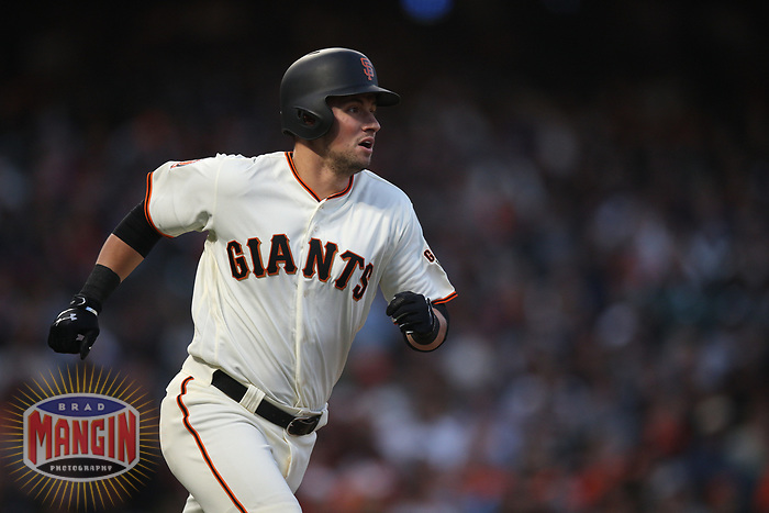 SAN FRANCISCO, CA - AUGUST 11:  Joe Panik #12 of the San Francisco Giants runs to first base against the Pittsburgh Pirates during the game at AT&T Park on Saturday, August 11, 2018 in San Francisco, California. (Photo by Brad Mangin)