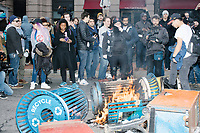 People crowd around as newspaper boxes and recycling bins are set on fire during street demonstrations after the inauguration of President Donald Trump on Jan. 20, 2017, in Washington, D.C.