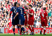 24th March 2018, Anfield, Liverpool, England; LFC Foundation Legends Charity Match 2018, Liverpool Legends versus FC Bayern Legends; Xabi Alonso of Liverpool Legends shares a joke with former team mates Luca Toni and Alexander Zickler after an FC Bayern Legends goal