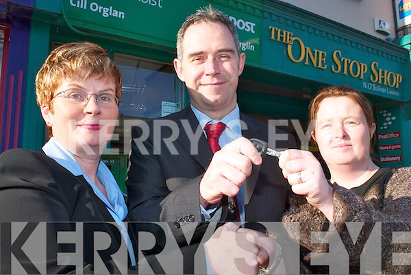 NEW CAR: Nora OSullivan, Killorglin Post Office, and Martin Manley, National Lottery representative, presents Catherine OConnor, Killorglin, with the keys to her new car last Thursday, which she won on the TV Game Show Winning Streak..