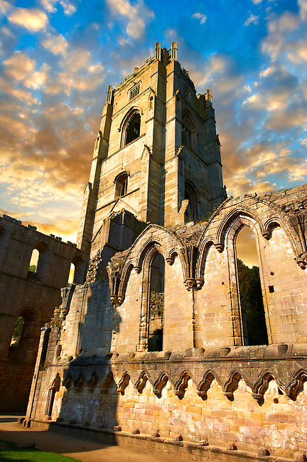Bell tower at sunrise  of Fountains Abbey , founded in 1132, is one of the largest and best preserved ruined Cistercian monasteries in England. The ruined monastery is a focal point of England's most important 18th century Water, the Studley Royal Water Garden which is a UNESCO World Heritage Site. Near Ripon, North Yorkshire, England