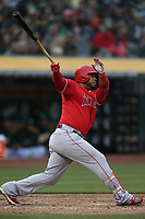 OAKLAND, CA - JUNE 15:  Luis Valbuena #18 of the Los Angeles Angels of Anaheim bats against the Oakland Athletics during the game at the Oakland Coliseum on Friday, June 15, 2018 in Oakland, California. (Photo by Brad Mangin)