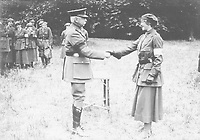 BNPS.co.uk (01202 558833)<br /> Pic: Pen&Sword/BNPS<br /> <br /> PICTURED: Sadie Bonnell receiving the Military Medal from General Plumer, France 1917.<br /> <br /> These inspiring photos of nurses on the front line feature in a new book which charts a century's heroic wartime service.<br /> <br /> The First Aid Nursing Yeomanry (FANY) was founded in 1907 by Captain Edward Baker with the early recruits trained in cavalry, signalling and camping.<br /> <br /> They were despatched to France at the outset for World War One to tend to injured troops on the battlefield, setting up hospitals for the many casualties. Other heroines dragged wounded personnel from exploding ammunition dumps.<br /> <br /> The brave nurses were again in the centre of the action in World War Two, performing sterling work in the harshest of conditions.<br /> <br /> Their stories feature in The First Aid Nursing Yeomanry in War and Peace, by Hugh Popham.