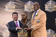 Canton, Ohio - August 8, 2015: Former NFL player Charles Haley poses with former San Francisco 49ers owner Edward DeBartolo, Jr., next to his bust during the 2015 Pro Football Hall of Fame enshrinement in Canton, Ohio, August 8, 2015. At the time of his induction, Haley was the  only player in NFL history to have played on five winning Super Bowl teams. (Photo by Don Baxter/Media Images International)