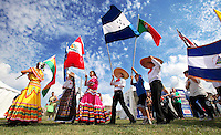 Children march with Latin American flags during the parade of countries Saturday at the Latino Heritage Festival at Blank Park.  The event, which continues Sunday, celebrates the Latino community's accomplishments and ethnicity.  Drawing several thousand, the festival is the largest ethnic event in the state of Iowa and features Latin American food, entertainment, cultural displays and vendors.