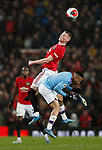 Scott McTominay of Manchester United rises above Gabriel Jesus of Manchester City during the Premier League match at Old Trafford, Manchester. Picture date: 8th March 2020. Picture credit should read: Darren Staples/Sportimage