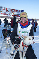 Jeremiah Klejka poses with his lead dogs Tundra (L) and Buckie after taking first place in the 2011 Jr. Iditarod   Willow, Alaska
