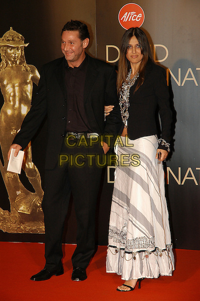 ROSITA CELENTANO & GUEST.David di Donatello Italian Awards at the Gran Teatro di Tor di Quinto, Rome, Italy, 14th June 2007..full length black and white print long maxi skirt jacket.CAP/CAV.©Luca Cavallari/Capital Pictures.