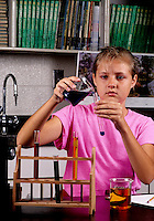 Student girl age 13 in Eighth grade learning science  learning  at lab desk