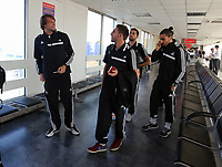 Wednesday 07 August 2013<br /> Pictured L-R: Michu, Angel Rangel, Jordi Amat and Chico Flores about to board their aeroplane at Cardiff Airport.<br /> Re: Swansea City FC travelling to Sweden for their Europa League 3rd Qualifying Round, Second Leg game against Malmo.