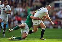 Mike Brown of England is tackled in possession. QBE International match between England and Ireland on September 5, 2015 at Twickenham Stadium in London, England. Photo by: Patrick Khachfe / Onside Images