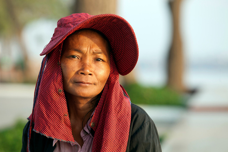 Portrait of a Cambodian woman along Mekong River early in the morning in Phnom Penh, Cambodia. <br /> <br /> Photos &copy; Dennis Drenner 2013.