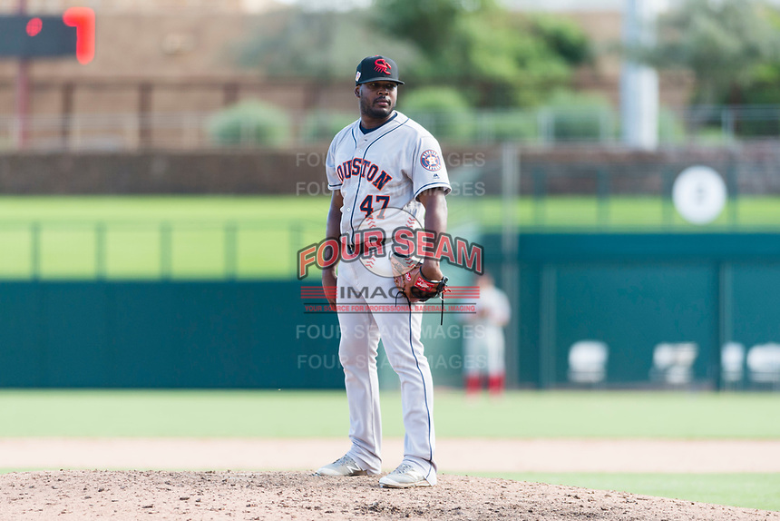 Scottsdale Scorpions relief pitcher Erasmo Pinales (47), of the Houston Astros organization, looks in for the sign during an Arizona Fall League game against the Glendale Desert Dogs at Camelback Ranch on October 16, 2018 in Glendale, Arizona. Scottsdale defeated Glendale 6-1. (Zachary Lucy/Four Seam Images)