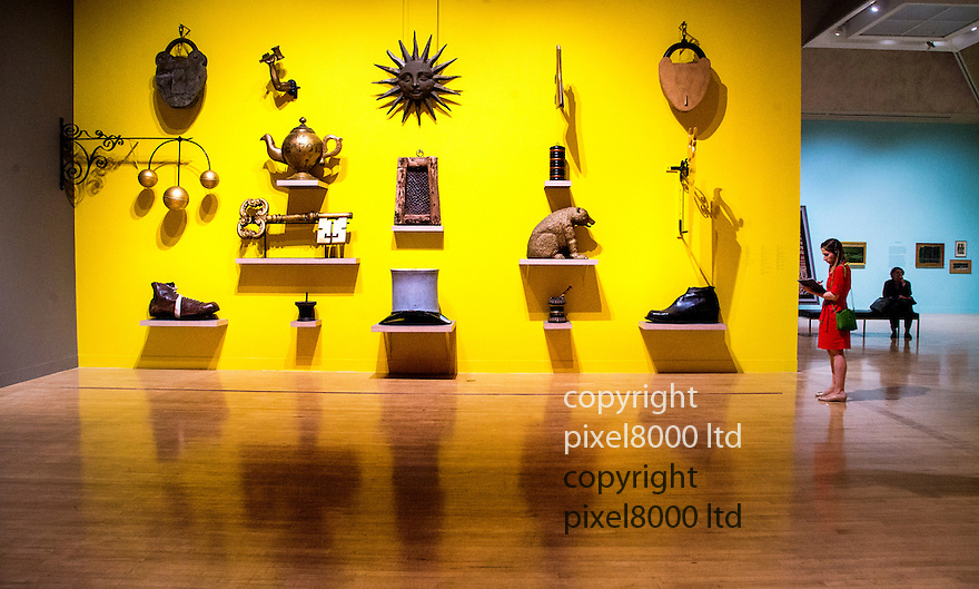 Exhibition of British Folk Art<br /> Tate Britain London<br /> Old shop signs :<br /> giant boots for cobblers'<br /> bear for barbers'<br /> balls for pawnbrokers'<br /> padlocks and keys for locksmiths'<br /> <br /> <br /> <br /> Pic by Gavin Rodgers/Pixel 8000 Ltd