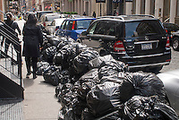 Piles of trash in plastic bags await pick-up curbside in New York on Saturday, April 28, 2012. (© Richard B. Levine)