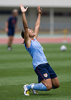 USWNT midfielder Angela Hucles celebrates a win by her team during practice at Anyang Sports Center in Seoul, South Korea.