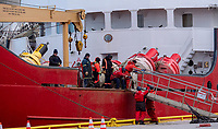 Sailors aboard the ice breaker Griffon attach a gangway to the ship berthed at the Government Dock.