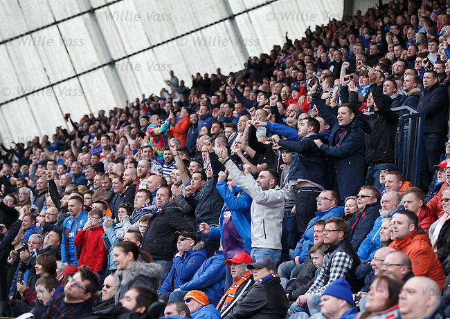 Rangers fans celebrate as news comes through from the Hibs match