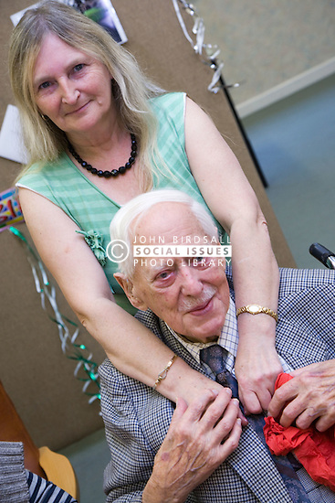 Woman with her elderly Father at his birthday party