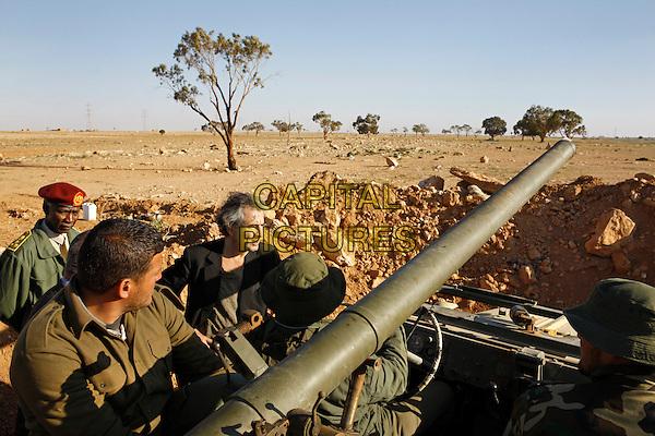 SCENE - BHL en Libye.Sur les lignes de défense de Benghazi, avec les rebelles volontaires recrutés par Mustapha Elsagezli, le chef des forces insurgées..in Le serment de Tobrouk (The Oath of Tobruk).*Filmstill - Editorial Use Only*.CAP/NFS.Supplied by Capital Pictures.