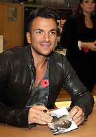 London Colney, Herts, UK - Peter Andre meets fans and signs copies of his new album 'Angels & Demons' at Sainsburys, London Colney, nr St Albans, Herts on October 29, 2012..Photo by Keith Mayhew