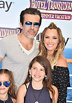 WESTWOOD, CA - JUNE 30: Edwin Arroyave, Teddi Jo Mellencamp and family attend the Columbia Pictures and Sony Pictures Animation's world premiere of 'Hotel Transylvania 3: Summer Vacation' at Regency Village Theatre on June 30, 2018 in Westwood, California.