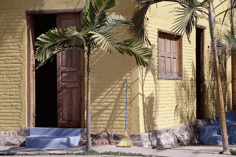 Yellow house in a small town near Porta Valliarta, Mexico.  Tango drum scan from 35mm slide film.  © John Birchard
