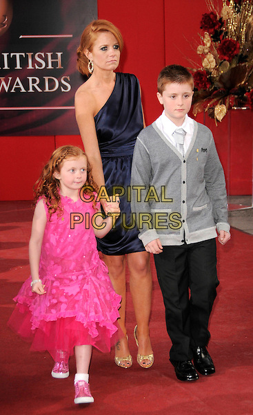 MAISIE SMITH, PATSY PALMER & JAMES FORDE .Arrivals - the British Soap Awards 2009, BBC Television Centre, Wood Lane, London, England, UK, May 9th 2009. soaps tv full length blue dress one shoulder pink grey gray cardigan holding hands kids children .CAP/CAS.©Bob Cass/Capital Pictures