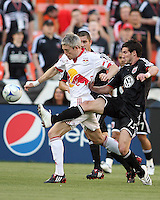 Chris Pontius #13 of D.C. United pokes the ball away from John Wolyniec #15 of New York Red Bulls during a U.S. Open Cup match at RFK Stadium on May 20 2009, in Washington D.C. D.C. United won 5-3.