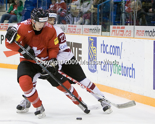 - Team Switzerland defeated Team Latvia 7-5 on Wednesday, December 30, 2009, at the Credit Union Centre in Saskatoon, Saskatchewan, during the 2010 World Juniors tournament.