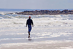 Man Enjoying a Walk on the Beach on the Coast of Maine