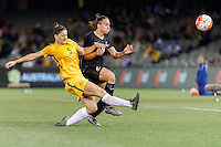 June 7, 2016: LAURA ALLEWAY (5) of Australia and JASMINE PEREIRA (8) of New Zealand fight for the ball during an international friendly match between the Australian Matildas and the New Zealand Football Ferns as part of the teams' preparation for the Rio Olympic Games at Etihad Stadium, Melbourne. Photo Sydney Low