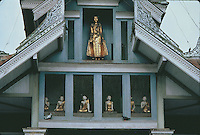 Figures of the Buddha in one of the many shrines which fringe the main terrace of the Shwedagon Pagoda.
