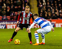 Sheffield United's midfielder Mark Duffy (21) Queens Park Rangers midfielder Josh Scowen (11) during the Sky Bet Championship match between Sheff United and Queens Park Rangers at Bramall Lane, Sheffield, England on 20 February 2018. Photo by Stephen Buckley / PRiME Media Images.