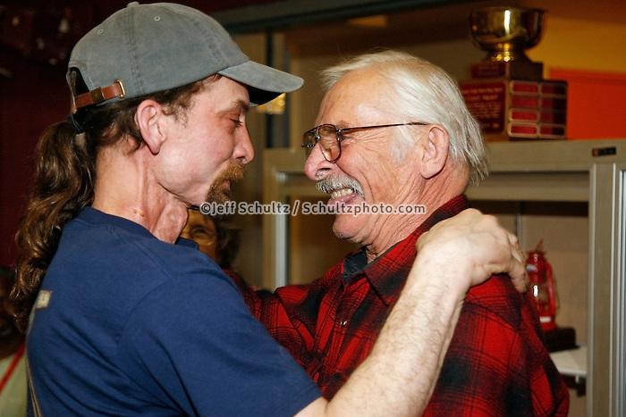 1978 Iditarod champion Dick Mackey (right) hugs his son Lance, the new 2007 Iditarod champion at the Nome awards banquet.