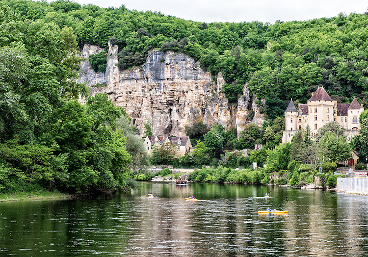 A look down the River Dordogne from the waterfront at La Roque-Gageac. The Château de La Malartrie appears at right.