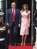 United States President Donald J. Trump and first lady Melania Trump exit the Diplomatic Entrance prior to welcoming King Abdullah II bin Al-Hussein and Queen Rania Al Abdullah of the Hashemite Kingdom of Jordan to the White House in Washington, DC on Monday, June 25, 2018.<br /> Credit: Ron Sachs / CNP
