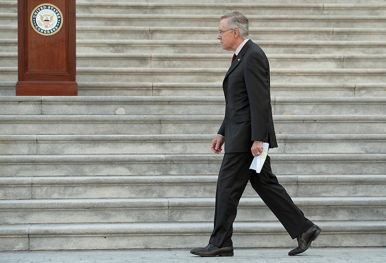 UNITED STATES - SEPTEMBER 12: Senate Majority Leader Harry Reid, D-Nev., arrives as both houses of Congress gather on the East Front steps of the Capitol to hold a 9/11 Remembrance Ceremony on Monday, Sept. 12, 2011. (Photo By Bill Clark/Roll Call)