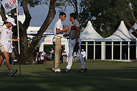 Micah Lauren Shin (USA) and Julian Suri (USA) on the 18th green during Round 4 of the UBS Hong Kong Open, at Hong Kong golf club, Fanling, Hong Kong. 26/11/2017<br /> Picture: Golffile | Thos Caffrey<br /> <br /> <br /> All photo usage must carry mandatory copyright credit     (&copy; Golffile | Thos Caffrey)