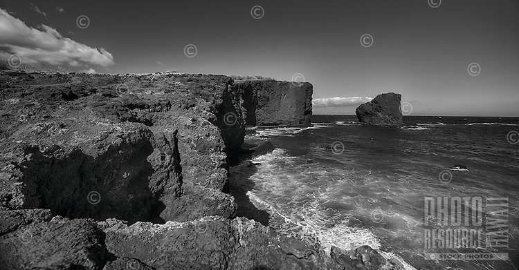 A black-and-white image of Sweetheart Rock (a.k.a. Pu'u Pehe Rock) near Hulopo'e Bay, Lana'i.