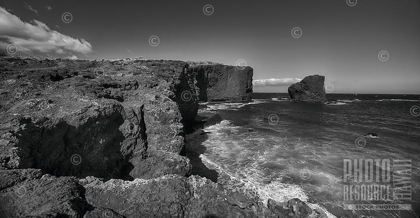 A black-and-white image of Sweetheart Rock (a.k.a. Pu'u Pehe Rock) near Hulopo'e Bay, Lana'i.
